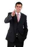 Portrait of a smiling businessman pointing forward Royalty Free Stock Images