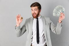 Portrait of a smiling businessman showing bitcoin Royalty Free Stock Images