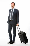 Portrait of a smiling businessman with suitcase Stock Image