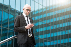 Portrait of smiling businessman using mobile smart phone royalty free stock photography