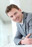 Portrait of smiling businessman waiting in hall Stock Photos