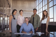 Portrait of smiling businessman with young team Royalty Free Stock Photo