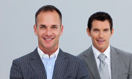 Portrait of smiling businessmen with folded arms Royalty Free Stock Image