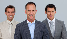Portrait of smiling businessmen with folded arms Stock Photography