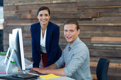 Portrait of smiling businesspeople working on personal computer. In office Royalty Free Stock Image