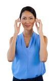 Portrait of smiling businesswoman adjusting imaginary eyeglasses Stock Images