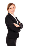 Portrait of a smiling businesswoman with arms folded Stock Images