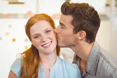 Portrait of smiling businesswoman being kissed Royalty Free Stock Images