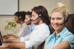 Portrait of smiling businesswoman in call center Stock Image