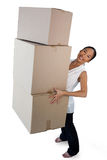 Portrait of smiling businesswoman carrying stack of cardboard boxes Stock Photo