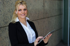 Portrait of smiling businesswoman with digital tablet pc Royalty Free Stock Image