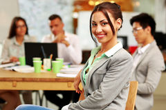 Portrait of a smiling businesswoman in front Stock Photography