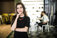 Portrait of smiling businesswoman in front of diverse business team. Royalty Free Stock Images