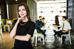 Portrait of smiling businesswoman in front of diverse business team. Royalty Free Stock Photos