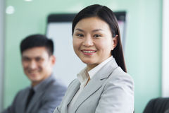Portrait of Smiling Businesswoman with her Colleague Royalty Free Stock Photography