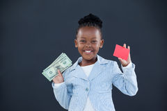 Portrait of smiling businesswoman holding currency and red card Royalty Free Stock Images