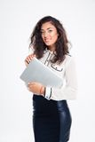Portrait of a smiling businesswoman holding laptop Stock Image