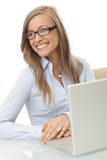 Portrait of smiling businesswoman with laptop Stock Image