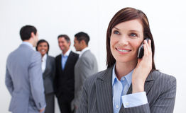 Portrait of smiling businesswoman on phone Stock Image
