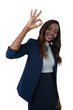Portrait of smiling businesswoman showing ok sign Royalty Free Stock Images