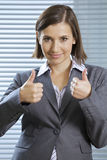 Portrait of smiling businesswoman showing thumbs up Stock Image