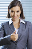Portrait of smiling businesswoman showing thumbs up Royalty Free Stock Images