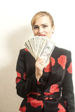 Portrait Smiling businesswoman in suit with dollars in her hand. On wallpaper background Royalty Free Stock Photos