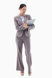 Portrait of a smiling businesswoman taking notes Royalty Free Stock Photography