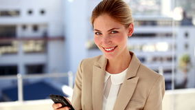 Portrait of smiling businesswoman text messaging stock footage