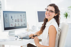 Portrait of smiling businesswoman using digitizer Royalty Free Stock Photography