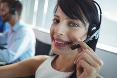 Portrait of smiling businesswoman using headset. At call center Royalty Free Stock Photo