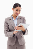 Portrait of a smiling businesswoman using a tablet computer Royalty Free Stock Images
