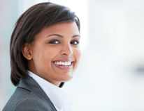 Portrait of a smiling businesswoman at work stock photography