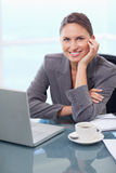 Portrait of a smiling businesswoman working with a notebook Royalty Free Stock Photos