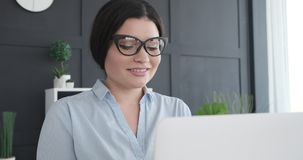 Portrait of smiling businesswoman working. On office laptop stock video footage
