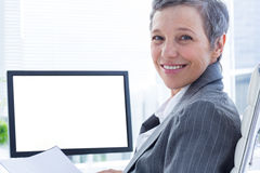 Portrait of smiling businsswoman using computer Royalty Free Stock Image