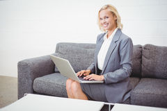 Portrait of smiling bussinesswoman working on laptop Royalty Free Stock Image
