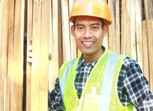 Portrait of a smiling carpenter holding wood Royalty Free Stock Photos