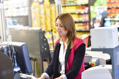 Portrait of smiling cashier working royalty free stock photo