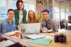 Portrait of smiling casual colleagues using computer Royalty Free Stock Photos