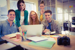 Portrait of smiling casual colleagues using computer Royalty Free Stock Images
