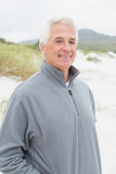 Portrait of a smiling casual senior man at beach Royalty Free Stock Image