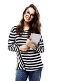 Portrait of a smiling casual woman holding tablet computer over white Stock Photos