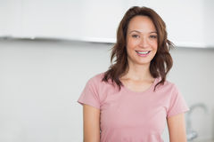 Portrait of a smiling casual woman in kitchen Royalty Free Stock Images