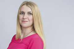 Portrait of Smiling Caucasian Blond Woman. Posing Against White Royalty Free Stock Photo