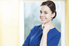 Portrait of Smiling Caucasian Brunette Woman In Stylish Blue Dress Royalty Free Stock Image