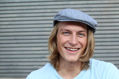Portrait of a smiling Caucasian man in newsboy hat looking to camera with copy space.  Stock Photos