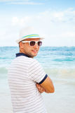 Portrait of smiling Caucasian man on the ocean coast Stock Photos