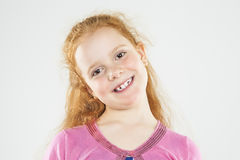 Portrait of Smiling Caucasian Redhaired Little Girl.Standing Aga Stock Photo