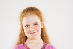 Portrait of Smiling Caucasian Redhaired Little Girl Stock Photos